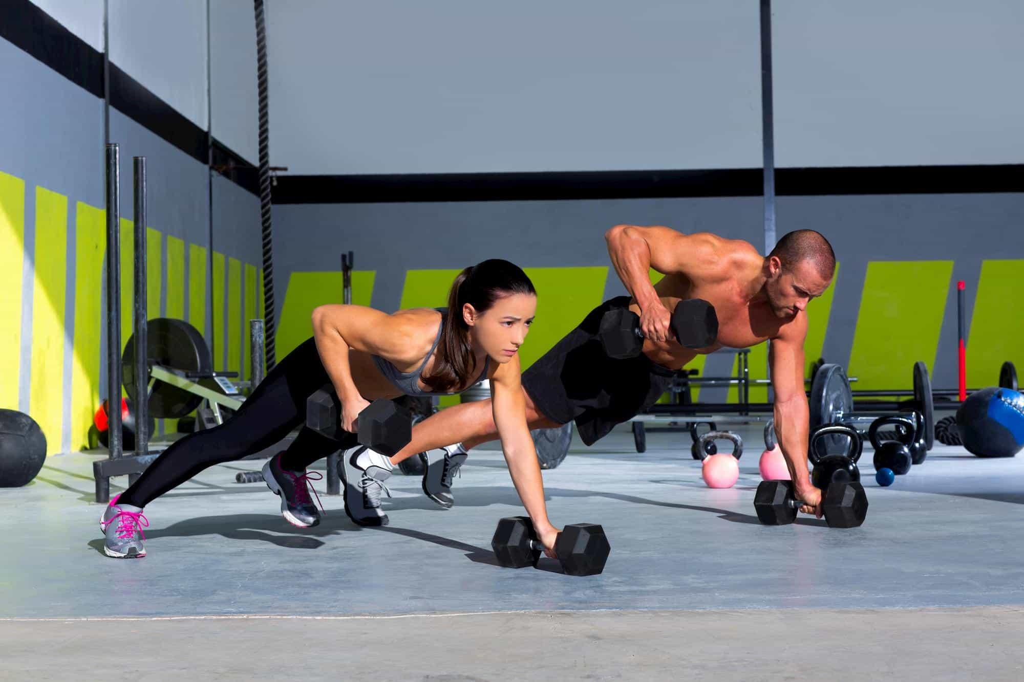 Man and woman doing push ups