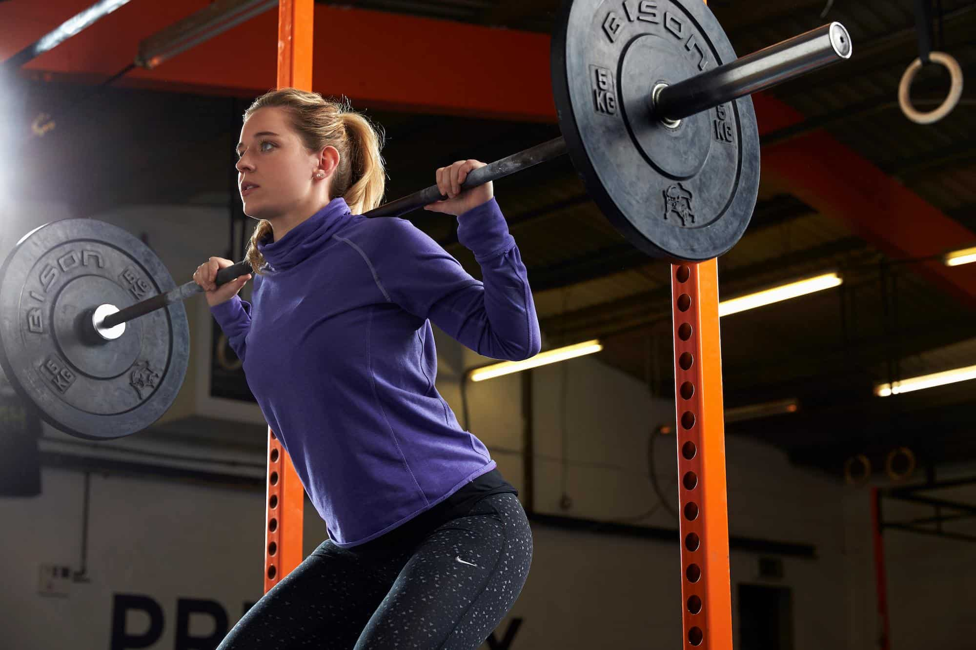 Woman using a power rack